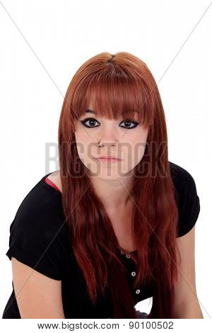 Teenage girl dressed in black with a piercing looking at camera isolated on white background