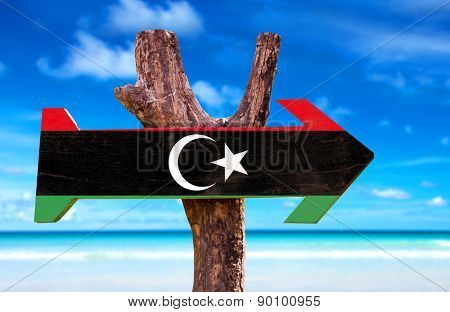 Libya Flag wooden sign with ocean background