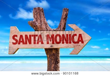 Santa Monica wooden sign with beach background