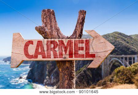 Carmel wooden sign with Big Sur on background