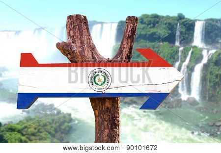 Paraguay Flag wooden sign with Igua�?�§u Falls on background