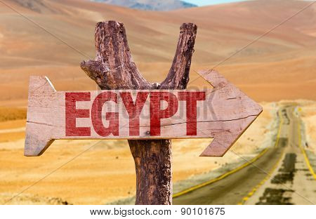 Egypt wooden sign with desert road background