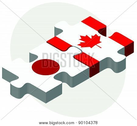 Japan And Canada Flags In Puzzle