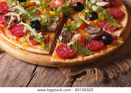 Pizza With Rucola, Salami And Olives Close-up Horizontal