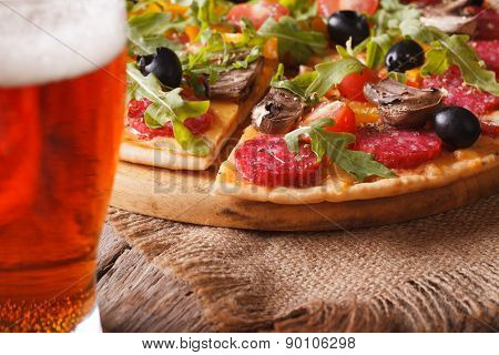 Sliced Pizza With Rucola Close-up And Beer, Horizontal