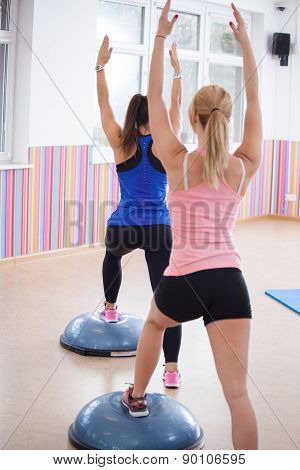 Women Training With Bosu Ball