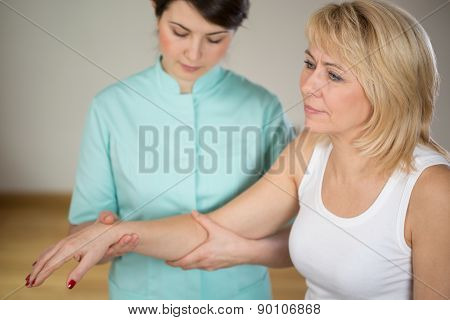 Adult Woman In Physiotherapist's Office