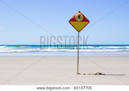 Danger sign on the beach in a summer day