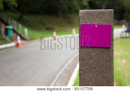 Blank purple milestone in a park