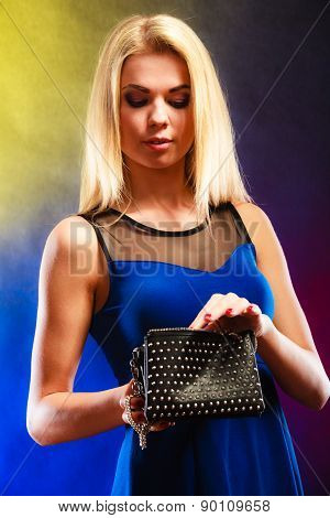 Elegant Woman Holds Black Handbag
