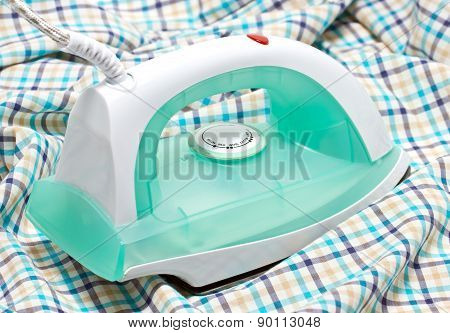 Dry Iron On Cloth Background.