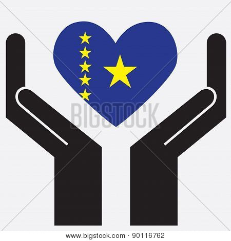 Hand showing Democratic Republic of Congo flag in a heart shape.