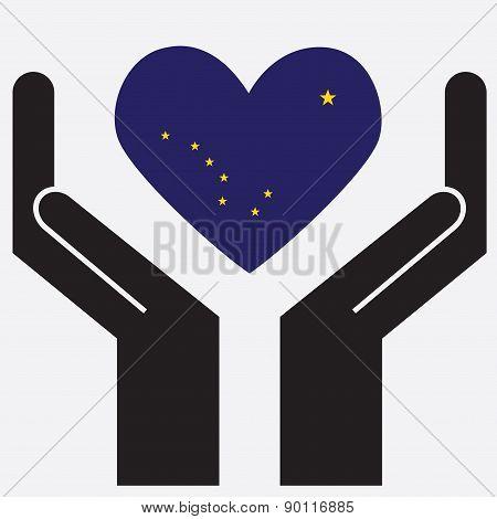 Hand showing Alaska flag in a heart shape.
