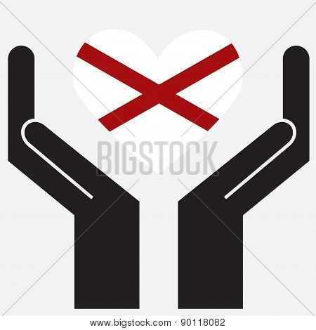 Hand showing Alabama flag in a heart shape.