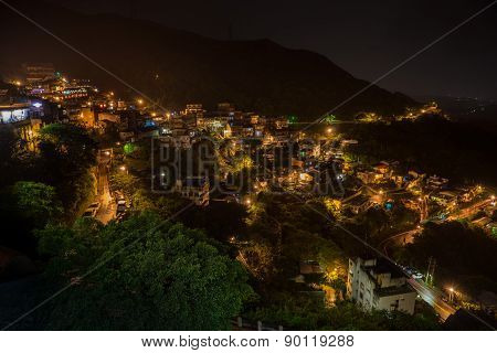 Jiufen, Taiwan hillside with old teahouses at night time