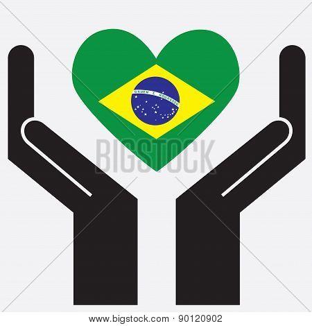 Hand showing Brazil flag in a heart shape.