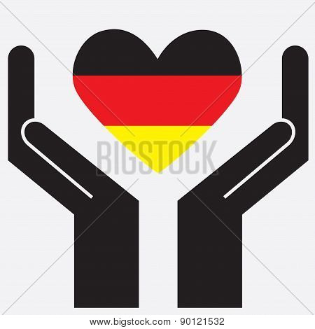 Hand showing Germany flag in a heart shape.
