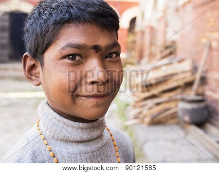 Sankhu, Nepal-oct 13 , 2012 : The Unidentified Boy Is Greeting People With His Welcome And Naive Smi