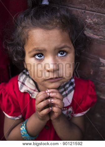 Bhaktapur, Nepal-oct 14 , 2012 : The Little Girl Is Asking For The Candy Even She Already Has One In