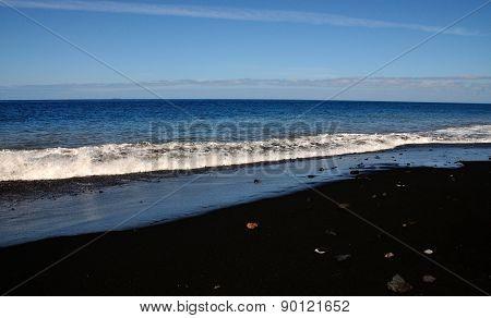 Rocks On Black Sand Beach