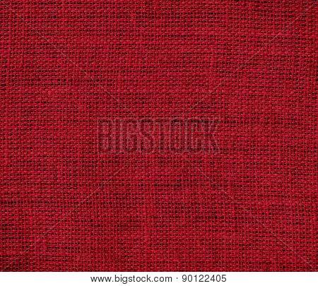 Carmine color burlap texture background