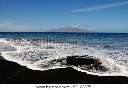 Tire On A Black Sand Beach