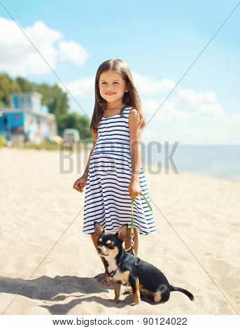Little Smiling Girl Walking With Dog On The Beach In Sunny Summer Day Near Sea, Child With Puppy Out