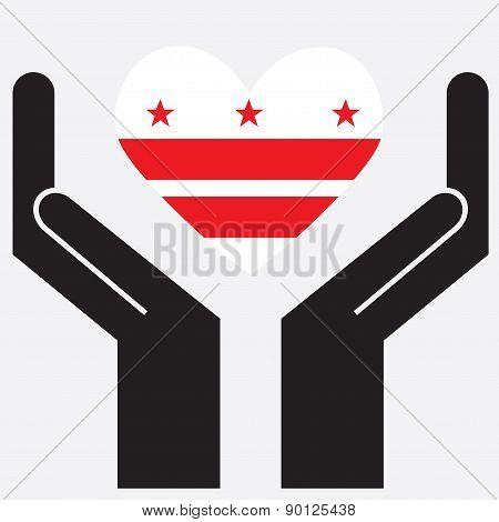 Hand showing Washington DC flag in a heart shape.