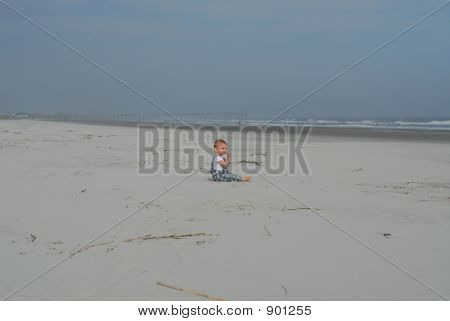 Lone Baby Eating Sand