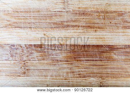 Wooden surface with scratches.