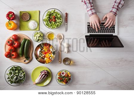 Man Searching For Recipes Online