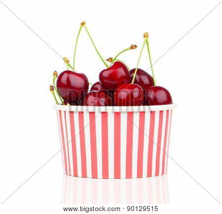 Fresh Cherry Berries In Striped Bucket On White Background