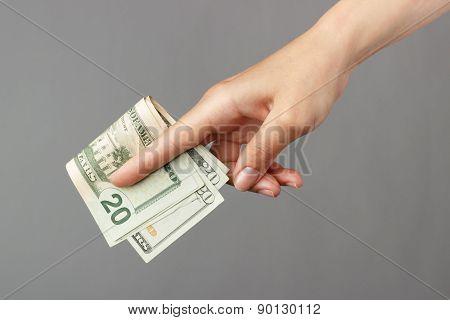 Female Hand On A Dark Background