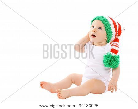 Cute Baby In The Hat Gnome Sitting And Looking Up