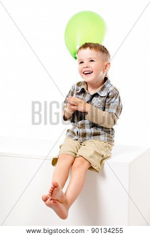 Pretty laughing boy with balloon