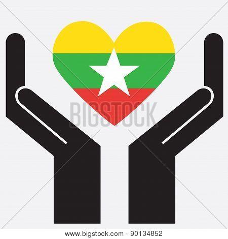 Hand showing Burma flag in a heart shape.