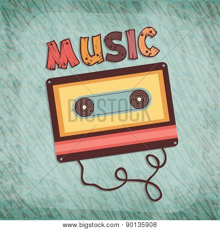 Vintage cassette tape and colorful wooden text Music on stylish green background.