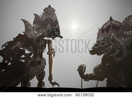 YOGYAKARTA, INDONESIA - AUGUST 13, 2012: Traditional Indonesian shadow puppet theatre wayang kulit performs on street during a religious festival in Yogyakarta, Central Java, Indonesia.
