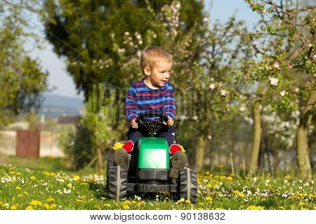 Little Boy  And Tractor.