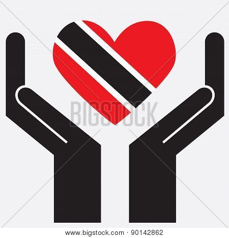 Hand showing Trinidad and Tobago flag in a heart shape.