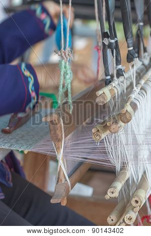Woman Weaving White Pattern On Loom