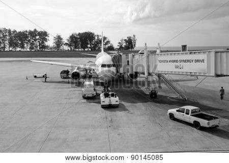 PHUKET, THAILAND - OCTOBER 25, 2011: Bangkok Air jet airplane docked in Phuket International Airport on. Bangkok Airways Public Company Limited is a regional airline based in Vibhavadi Rangsit Road