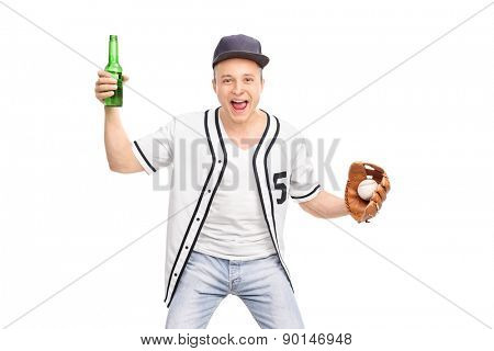 Excited guy in a white baseball shirt holding a beer in one hand and a baseball in the other and cheering isolated on white background