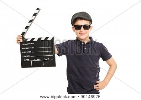Little boy with a beret and sunglasses holding a movie clapperboard isolated on white background
