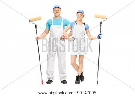 Male and a female house painters holding paint rollers and posing in white uniforms isolated on white background