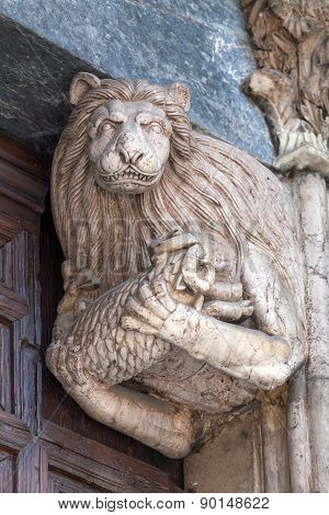 Sculpture Of A Lion Holding A Lamb In The Doorway Of The Monza Cathedral