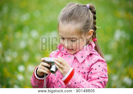 Girl Reviewing Photos She Made With Digital Camera