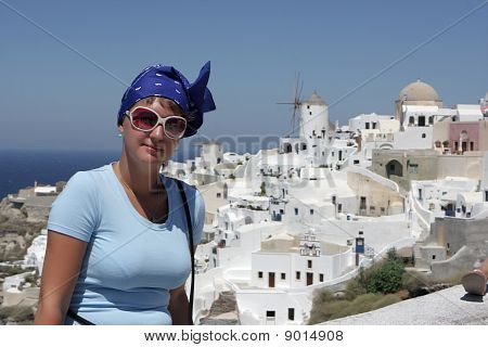Woman Poses On Oia Background At Santorini
