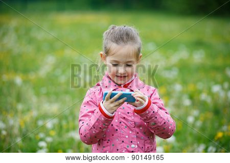Girl Watching Cartoon And Playing Games On Smartphone