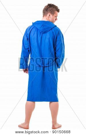 Handsome young man wearing blue bathrobe, isolated